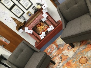 Photo of two chairs and fireplace in the media center with letters flying out of the fireplace to replicate a scene from Harry Potter and the Sorcerer's Stone